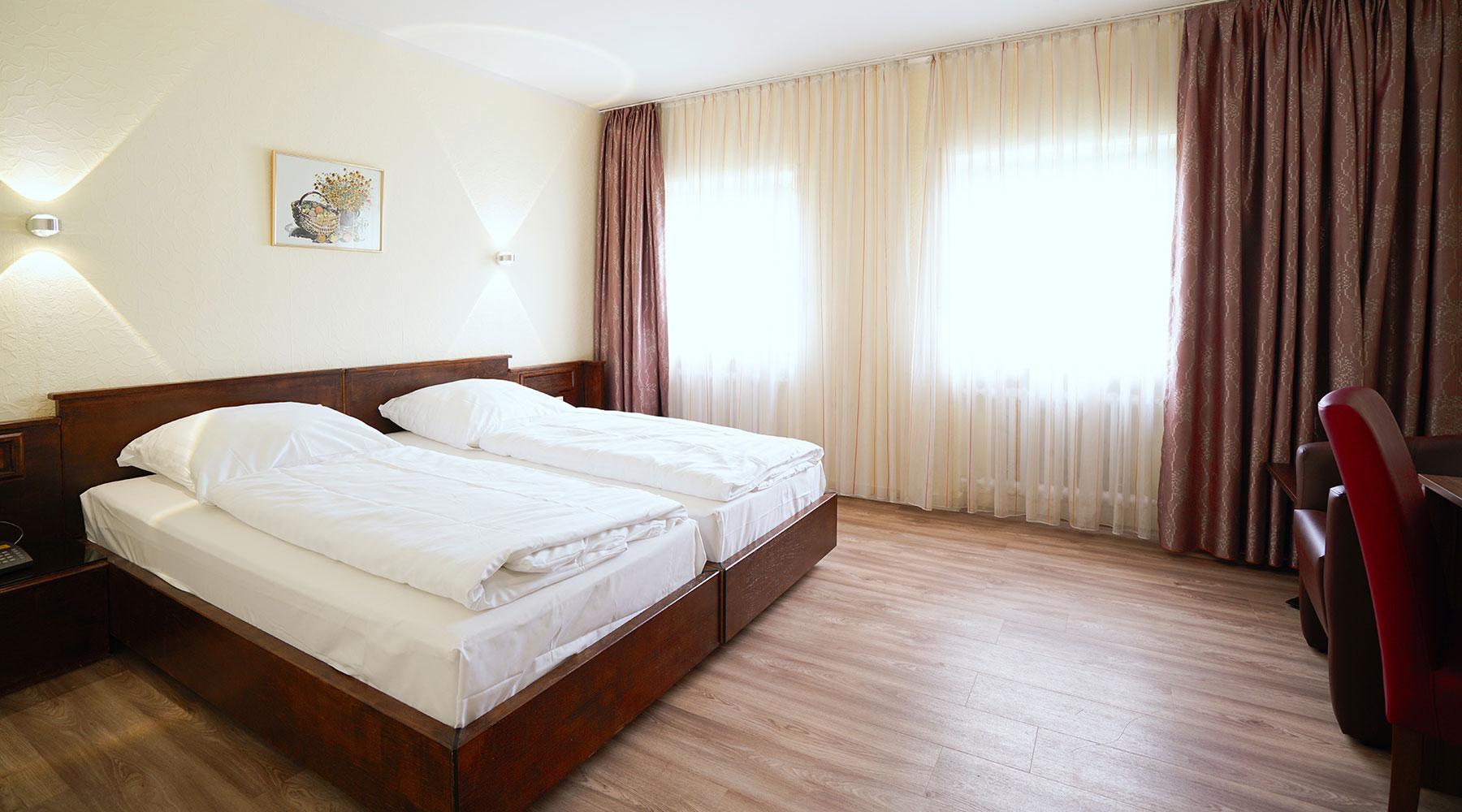 Doppel-/ Zweibettzimmer